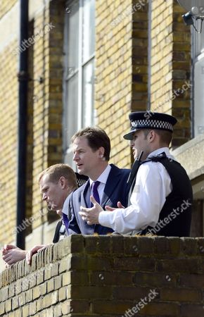 Nick Clegg with Jeremy Browne, Minister for Crime Prevention and local police officers