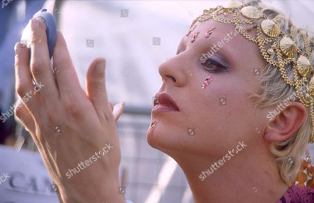A transvestite applies his make up
