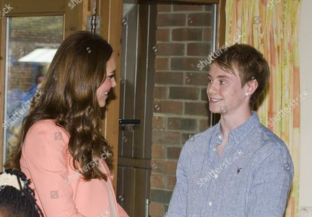 Catherine Duchess of Cambridge meeting singer/songwriter Ollie Wade who sang a song 'Free' as a tribute to his deceased brother