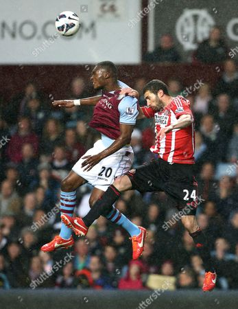 Christian Benteke of Aston Villa and Carlos Cuellar of Sunderland