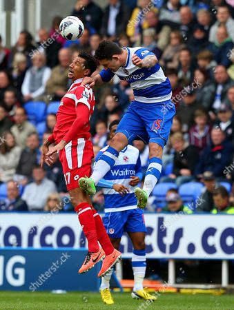 Jay Bothroyd of Queens Park Rangers and Sean Morrison of Reading in action