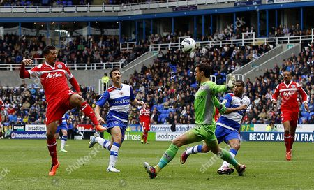 Jay Bothroyd of Queens Park Rangers beats goalkeeper Alex McCarthy of Reading but his shot goes just wide of the post