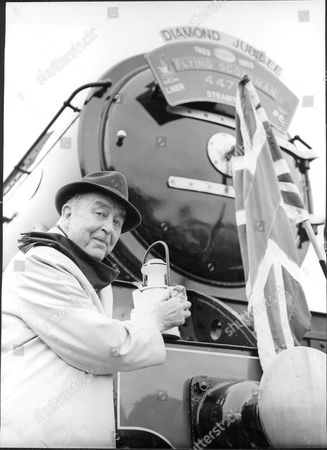 Editorial image of Actor Ray Milland With Steam Train The Flying Scotsman Ray Milland (3 January 1907 Oo 10 March 1986) Was A Welsh Actor And Director. His Screen Career Ran From 1929 To 1985 And He Is Best Remembered For His Academy Awardoowinning Portrayal Of An Alco