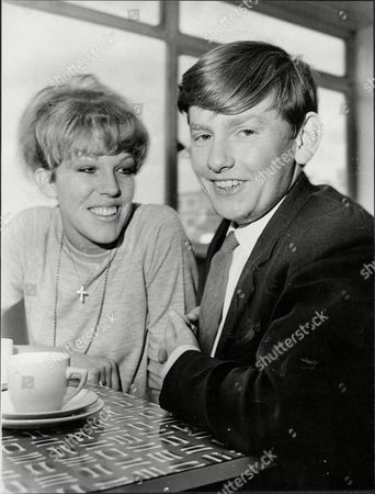 Actor Roger Tonge And Actress Sue Nichols Roger Tonge (30 January 1946 Oo 26 February 1981) Was A British Actor. He Was Born Anthony Roger Tonge In Birmingham Where He Attended Lordswood Technical Grammar School. He Was Working As An Ii8-a-week Post Office Clerk And Performing In Amateur Dramatics In The Evenings When He Landed The Role Of Sandy Richardson The Motel Owner's Son In The Atv Soap Opera Crossroads A Role He Would Play For 17 Years. He Played The Disabled Son Of Meg Richardson Played By The Actress Noele Gordon In The Much Maligned Soap Opera. The Character Had Come Down With A Temporary Illness As Part Of The Ongoing Plot And A Full Recovery Was Planned Until Someone Wrote In And Pointed Out That People Do Not Make Full Recoveries From That Illness Which Necessitated The Star To Use A Wheelchair For The Rest Of His Time On The Show.