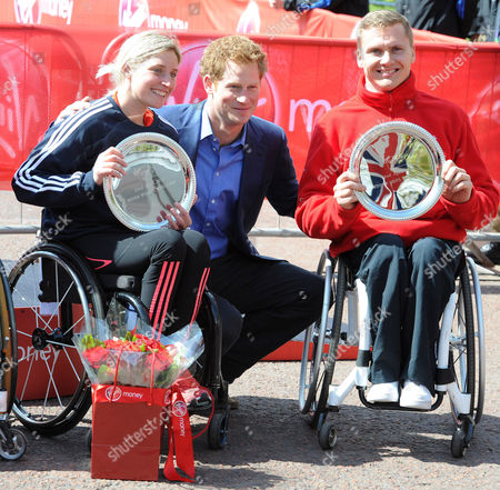 Prince Harry With The Elite Winners Of Today's London Marathon Wheelchair Race David Weir (r) And Shelly Woods (l). Prince Harry Is Presenting The Prizes To The Winners Of Today's Race.