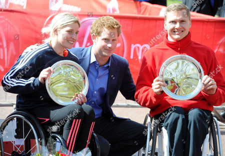 Picture Shows Prince Harry With The Elite Winners Of Today's London Marathon Wheelchair Race David Weir (r) And Shelly Woods (l). Prince Harry Is Presenting The Prizes To The Winners Of Today's Race.