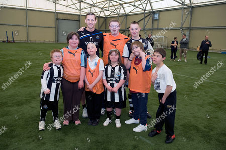 Newcastle United Fc Training Ground Feature. Newcastle Peter Lovenkrands With Community Project For Downs Childern At Their Training Ground.