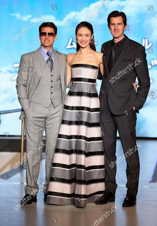 Stock Image of Tom Cruise, Olga Kurylenko, director Joseph Kosinsk