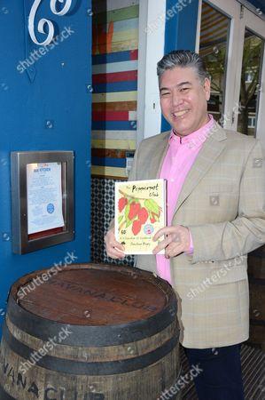 Jonathan Phang with his book