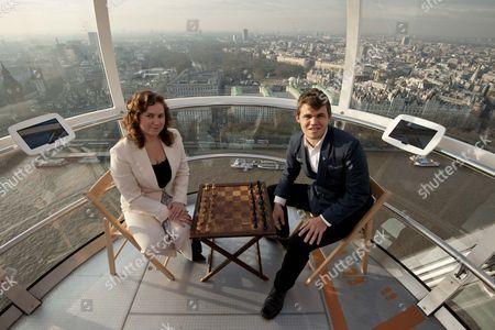 Stock Image of Hungarian chess player Judit Pulgar and Norwegian player Magnus Carlsen on the London Eye