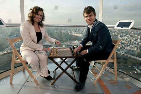 Stock Photo of Hungarian chess player Judit Pulgar and Norwegian player Magnus Carlsen on the London Eye