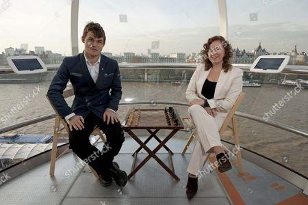 Norwegian chess player Magnus Carlsen and Hungarian player Judit Pulgar on the London Eye