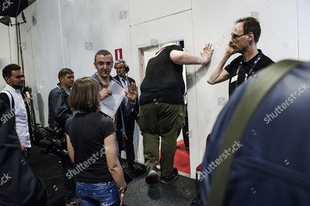Stock Picture of Igor Vovkovinskiy bending down to get through a stage door
