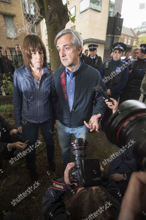 Chris Huhne arriving back at his home in Clerkenwell after serving 2 months in prison he is pictured with Carina Trimingham his partner