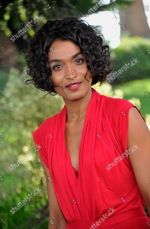 Sara Martins poses for photographers during a photocall as she promotes 'Death in Paradise' at the annual MIPCOM television programme market in Cannes, France.