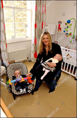 Annabel Heseltine Property / Nanny Feature. Annabel In The Babies Bedroom With Twins Isabella And Mungo. With Her Splendid Six-storey White Stucco Victorian Villa In A Fashionable Area Of London Annabel Heseltine Has Space To Spare In Her 12-room House Some Of Which She Has Had Refurbished For Her New Nanny.
