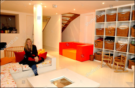 Annabel Heseltine Property / Nanny Feature. Pic Shows: Annabel Heseltine In The Basement Room Which Has Been Kitted Out For Use As A Playroom. The Nanny Can Also Use It As A Space For Entertaining. With Her Splendid Six-storey White Stucco Victorian Villa In A Fashionable Area Of London Annabel Heseltine Has Space To Spare In Her 12-room House Some Of Which She Has Had Refurbished For Her New Nanny.
