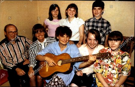 Russian Children Irina Boukhtoyarov On Guitar With Husband Sascha (serge) And Caroline Cox (baroness Cox) In Their Moscow Flat With 5 Of Their Foster Children.