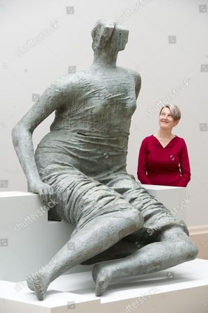 Tate Britain Director Penelope Curtis with 'Draped Seated Figure', 1957-1958, by Henry Moore