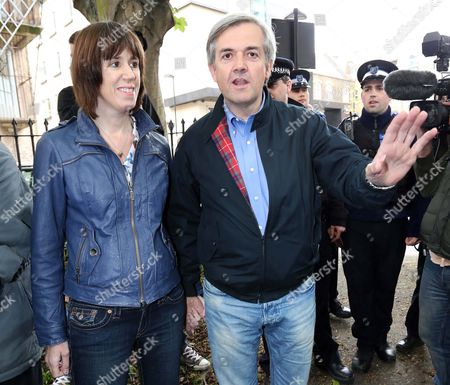 Chris Huhne arriving back at his home with girlfriend Carina Trimingham