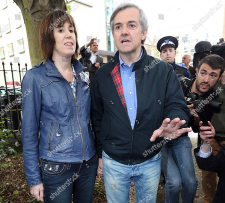 Chris Huhne arriving back at his home in London with girlfriend Carina Trimingham