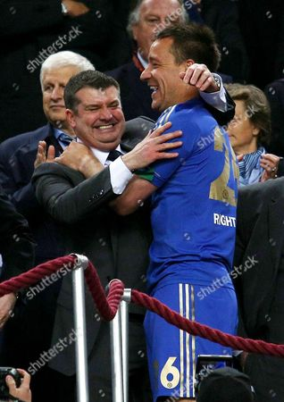 John Terry of Chelsea hugs chief executive Ron Gourlay at the end of the game
