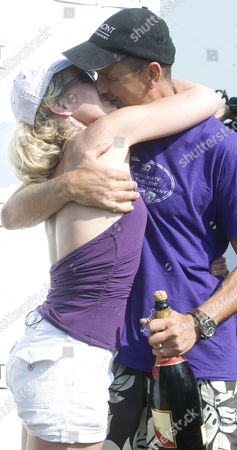 Stuntman Gary Connery 35 Celebrates With Wife Vivienne After Performing An Extraordinary Stunt Jumping Off Beachy Head In Sussex. Connery Maidenhead Berkshire Opening His Parachute As He Headed Towards The Rocks 450ft Below. Everything Went According To Plan And 12 Seconds After Leaping From The Notorious Suicide Spot He Landed Safely On Cardboard Boxes On The Beach.