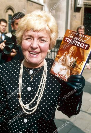 Editorial photo of LYNNE PERRIE WITH HER BOOK ON TV SERIES 'CORONATION STREET', BRITAIN - 1994