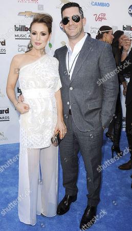 Stock Photo of Alyssa Milano and husband David David Bugliari