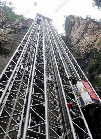 Editorial image of French daredevil Jean-Michel Casanova climbs the Bailong Elevator, Jiajiazhe, Hunan Province, China - 18 May 2013