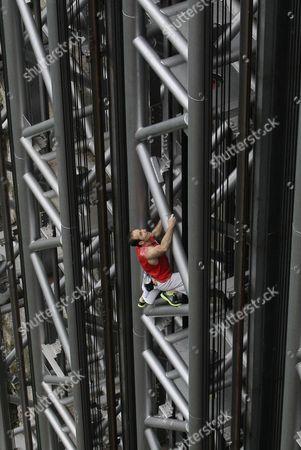 Stock Photo of Jean-Michel Casanova climbing the elevator