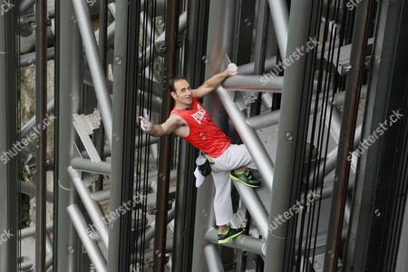 Stock Image of Jean-Michel Casanova climbing the elevator