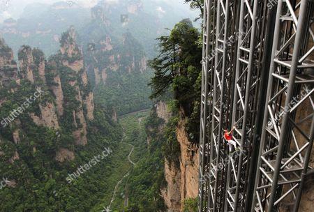 Stock Picture of Jean-Michel Casanova climbing the elevator