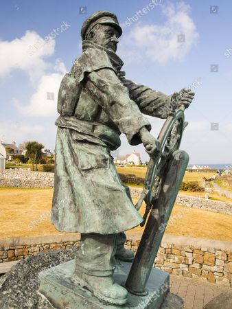 A bronze statue to Dick Evans the coxswain of the Moelfre lifeboat, on Anglesey, Wales, Britain