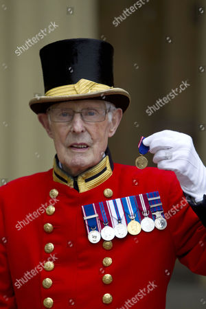Stock Picture of Pat Carroll, for 60 years service at Buckingham Palace.