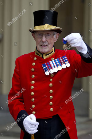 Stock Image of Pat Carroll, for 60 years service at Buckingham Palace.