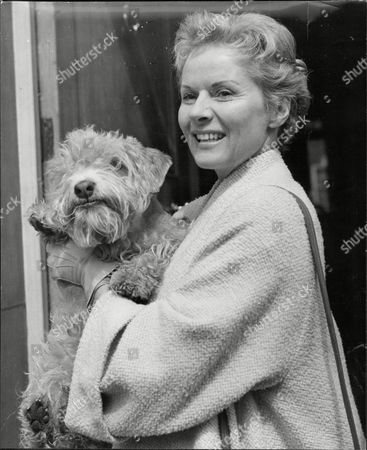 Actress Ann Todd With Her Sealyham Whisky Dog In Her Arms Dorothy Anne Todd (24 January 1909 Oo 6 May 1993) Was An English Actress And Producer. She Was Born In Hartford Cheshire And Was Educated At St. Winifrid's School Eastbourne Sussex. She Became A Popular Actress From Appearing In Such Films As Perfect Strangers (1945) (as A Nurse) And The Seventh Veil (1945) (as A Troubled Concert Pianist). She Is Perhaps Best Known To American Audiences As Gregory Peck's Long-suffering Wife In Alfred Hitchcock's The Paradine Case (1947). She Later Produced A Series Of Travel Films. Her Autobiography Is Entitled The Eighth Veil An Allusion To The Film Which Made Her A Star In Britain. Todd Was Known As The 'pocket Garbo' For Her Diminutive Blonde Beauty.