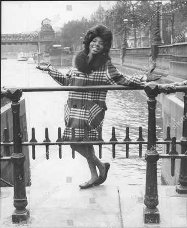 Pop Group Martha And The Vandellas At Victoria Embankment In London Pictured Rosalind Ashford Martha And The Vandellas (known From 1967 To 1972 As Martha Reeves And The Vandellas) Were An American Vocal Group Who Found Fame In The 1960s With A String Of Hit Singles On Motown's Gordy Label. Founded In 1960 By Friends Annette Beard Rosalind Ashford And Gloria Williams The Band Eventually Included Martha Reeves Who Moved Up In Ranks As Lead Vocalist Of The Group After Williams' Departure In 1962. The Group Signed With And Eventually Recorded All Of Their Singles For Motown's Gordy Imprint. The Group's String Of Hits Included '(love Is Like A) Heat Wave' 'nowhere To Run' 'jimmy Mack' 'bless You' And 'dancing In The Street' The Latter Song Becoming Their Signature Single. During Their Nine-year Run On The Charts From 1963 To 1972 Martha And The Vandellas Charted Over Twenty-six Hits And Recorded In The Styles Of Doo-wop R&b Pop Blues Rock And Roll And Soul. Ten Vandellas Songs Reached The Top Ten Of The Billboard R&b Singles Chart Including Two R&b Number Ones. In 2004 Rolling Stone Ranked Martha And The Vandellas #96 On Their List Of The 100 Greatest Artists Of All Time.