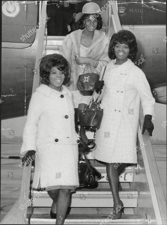 Pop Group Martha And The Vandellas Arrive At Lap Martha And The Vandellas (known From 1967 To 1972 As Martha Reeves And The Vandellas) Were An American Vocal Group Who Found Fame In The 1960s With A String Of Hit Singles On Motown's Gordy Label. Founded In 1960 By Friends Annette Beard Rosalind Ashford And Gloria Williams The Band Eventually Included Martha Reeves Who Moved Up In Ranks As Lead Vocalist Of The Group After Williams' Departure In 1962. The Group Signed With And Eventually Recorded All Of Their Singles For Motown's Gordy Imprint. The Group's String Of Hits Included '(love Is Like A) Heat Wave' 'nowhere To Run' 'jimmy Mack' 'bless You' And 'dancing In The Street' The Latter Song Becoming Their Signature Single. During Their Nine-year Run On The Charts From 1963 To 1972 Martha And The Vandellas Charted Over Twenty-six Hits And Recorded In The Styles Of Doo-wop R&b Pop Blues Rock And Roll And Soul. Ten Vandellas Songs Reached The Top Ten Of The Billboard R&b Singles Chart Including Two R&b Number Ones. In 2004 Rolling Stone Ranked Martha And The Vandellas #96 On Their List Of The 100 Greatest Artists Of All Time.