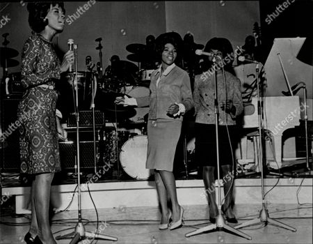 Pop Group Martha And The Vandellas At The Royal Albert Hall Martha And The Vandellas (known From 1967 To 1972 As Martha Reeves And The Vandellas) Were An American Vocal Group Who Found Fame In The 1960s With A String Of Hit Singles On Motown's Gordy Label. Founded In 1960 By Friends Annette Beard Rosalind Ashford And Gloria Williams The Band Eventually Included Martha Reeves Who Moved Up In Ranks As Lead Vocalist Of The Group After Williams' Departure In 1962. The Group Signed With And Eventually Recorded All Of Their Singles For Motown's Gordy Imprint. The Group's String Of Hits Included '(love Is Like A) Heat Wave' 'nowhere To Run' 'jimmy Mack' 'bless You' And 'dancing In The Street' The Latter Song Becoming Their Signature Single. During Their Nine-year Run On The Charts From 1963 To 1972 Martha And The Vandellas Charted Over Twenty-six Hits And Recorded In The Styles Of Doo-wop R&b Pop Blues Rock And Roll And Soul. Ten Vandellas Songs Reached The Top Ten Of The Billboard R&b Singles Chart Including Two R&b Number Ones. In 2004 Rolling Stone Ranked Martha And The Vandellas #96 On Their List Of The 100 Greatest Artists Of All Time.