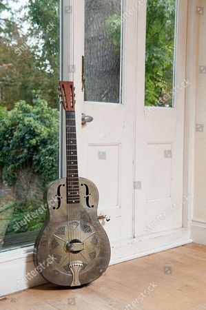 London United Kingdom - October 2: A 1935 National Resonator Steel Guitar Used By English Singer-songwriter Ralph Mctell - October 2