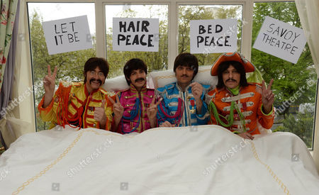 The cast stage a recreation of the famous 'bed-in' scene - Reuven Gershon as John Lennon, Luke Roberts as Ringo Starr, Emanuele Angeletti as Paul McCartney and Stephen Hill as George Harrison