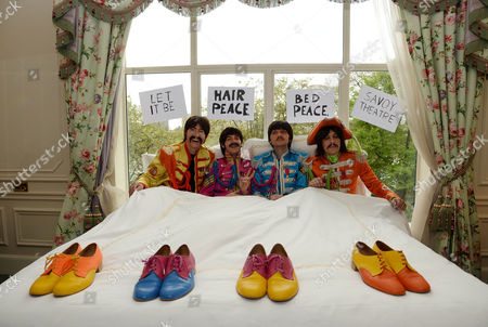 Stock Picture of The cast stage a recreation of the famous 'bed-in' scene - Reuven Gershon as John Lennon, Luke Roberts as Ringo Starr, Emanuele Angeletti as Paul McCartney and Stephen Hill as George Harrison