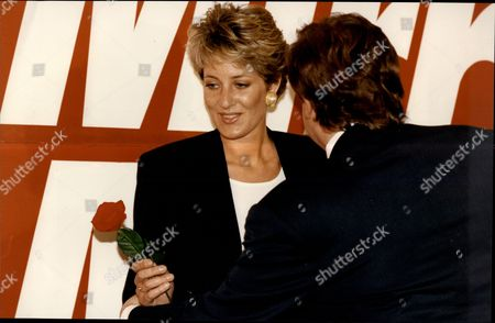 Stock Photo of A Princess Diana Lookalike Presents A Rose To Royal Reporter James Whittaker.