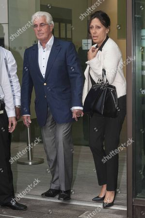 Max Clifford and wife Jo Westwood leaving court