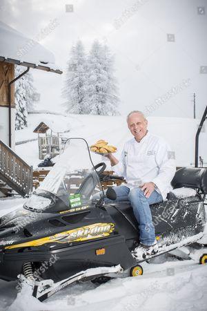 Chef John Burton Race on a skidoo in the Italian Alps