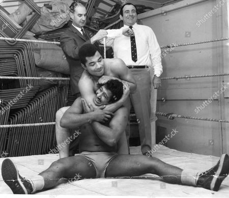 Mick Mcmanus Being Measured For A Savile Row Suit By Tailor Dennis Fremantle While Wrestlers Rajendra Singh (sitting) And Len Hurst Rehearse. Mick Mcmanus Died In May 2013.