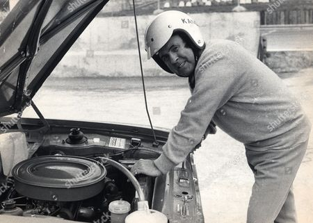 Wrestler Mick Mcmanus Checking Out A Car Engine. Mick Mcmanus Died In May 2013.