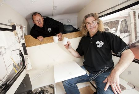 Stock Picture of Andy Saunders and work colleague Martin Ford inside the cramper van