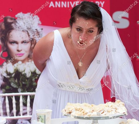 Stock Image of Cake eating contest winner Jennifer Paolotti